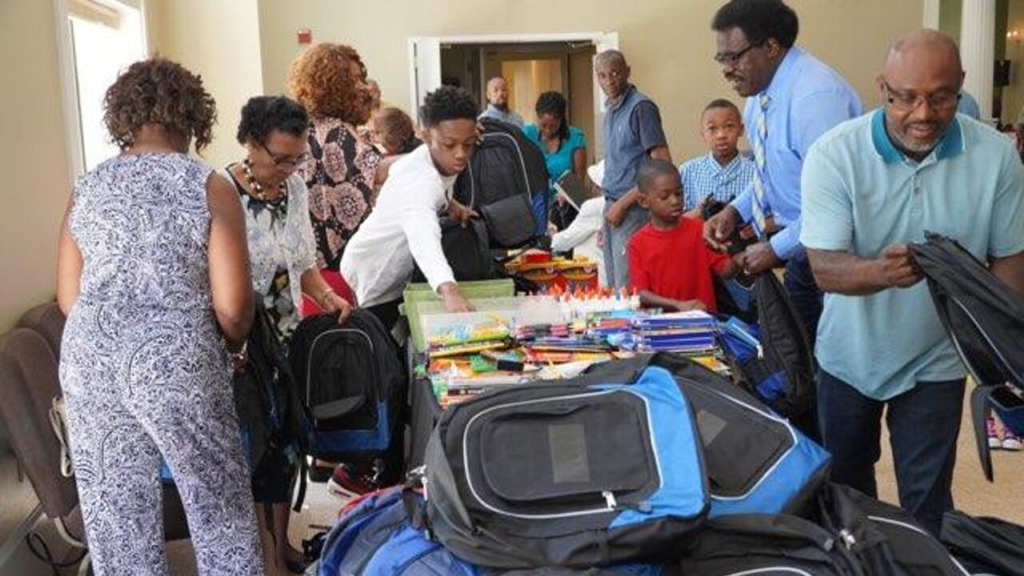 Giving out school supplies and backpacks