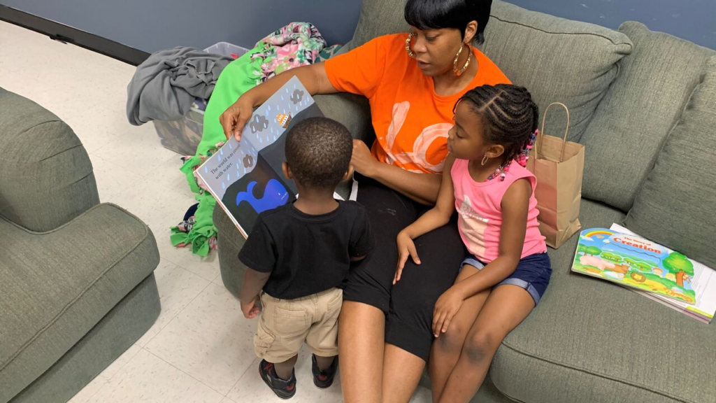 Mother and children read a book in North Carolina